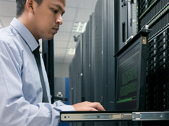 man working with mainframe